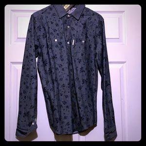 Long sleeve button casual shirt.